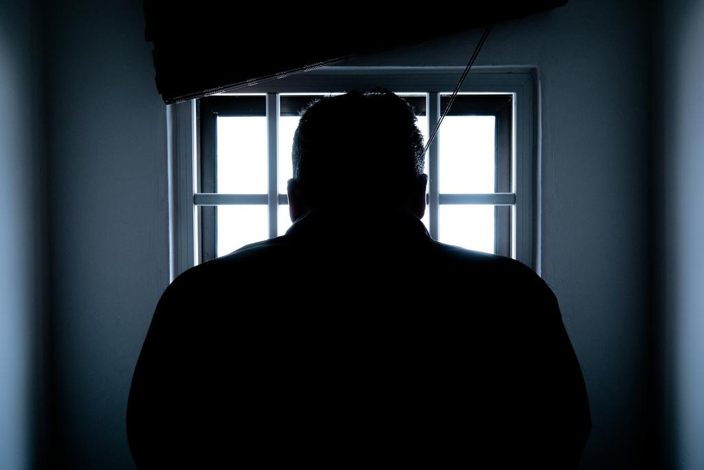 Silhouette of prosecuted man