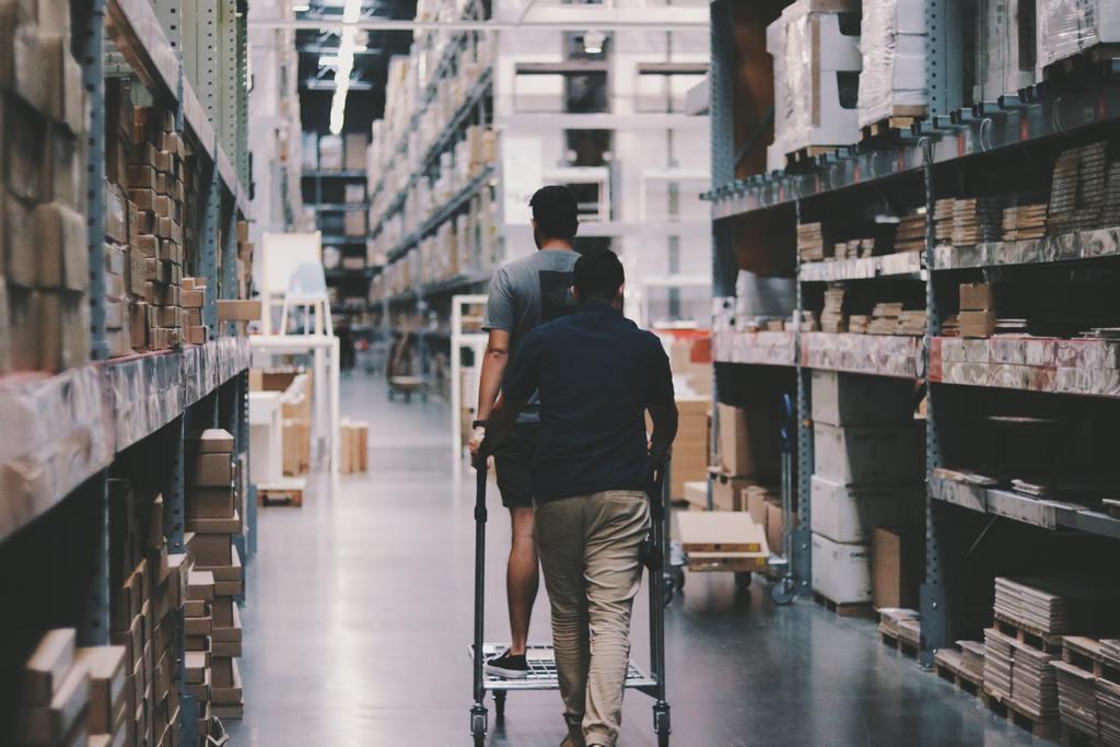 Men walking through inventory in warehouse